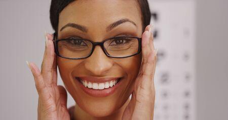 Happy black woman wearing eyeglasses