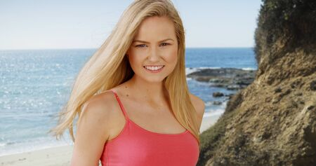 oc: Pretty caucasian woman smiling on a sunny day at the beach. Stock Photo