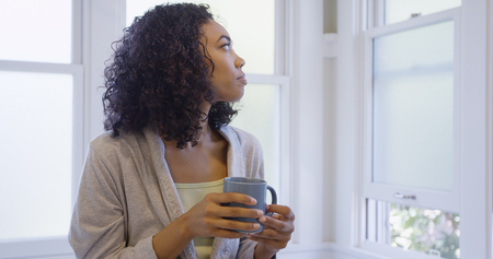 Healthy young black woman looking away