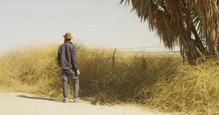 Sexy Hispanic man standing on the side of a road 版權商用圖片