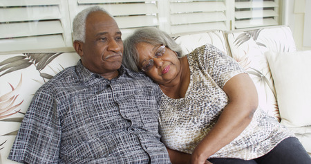 Senior African couple relaxing on a couch
