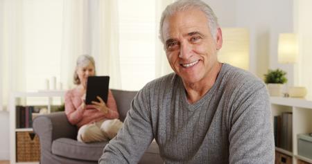 Handsome senior man smiling at camera