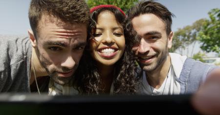 Portrait of mixed ethnic hipster friends taking selfie 免版税图像
