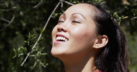 Portrait of young Asian woman taking break after run 免版税图像
