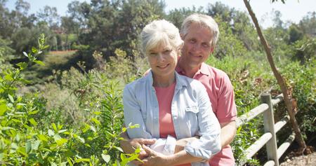 Portrait of a happy mature caucasian couple at a park