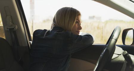 Young beautiful caucasian woman parked