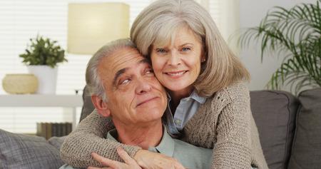 Mature couple smiling looking at camera
