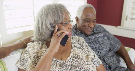 Elderly black woman chatting on the phone