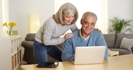 Senior adults using laptop computer at desk