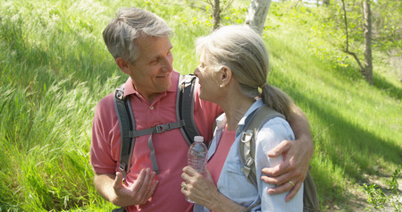Senior caucasian man talking with wife at a park