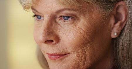 Gorgeous mature woman looking away closeup
