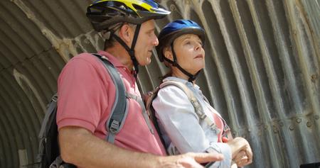 Elderly white couple at the park taking bike break