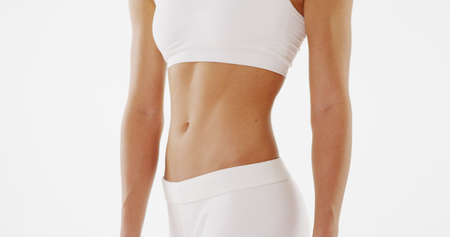 Healthy fit woman standing white background