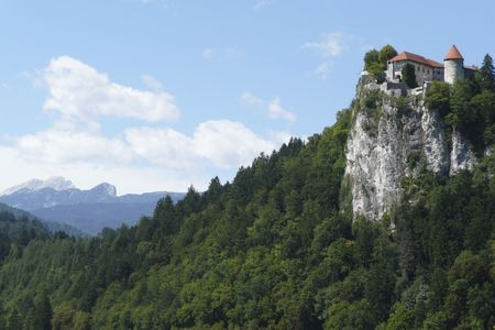 Old castle sits atop the cliffs overlooking scenic Lake Bled, Slovenia.