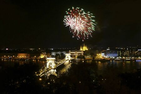 Unexpected fireworks appear over the Chain Bridge, as viewed from Castle District, Budapest.