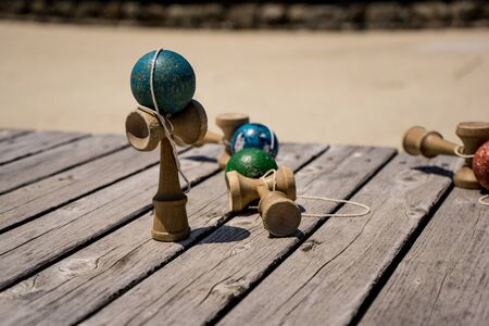 Japanese toy wooden Kendama on the wooden table