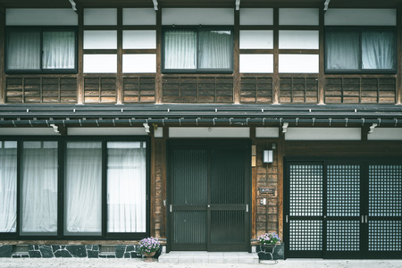 Exterior Traditional Japanese style house with modern door and windows, cool tone