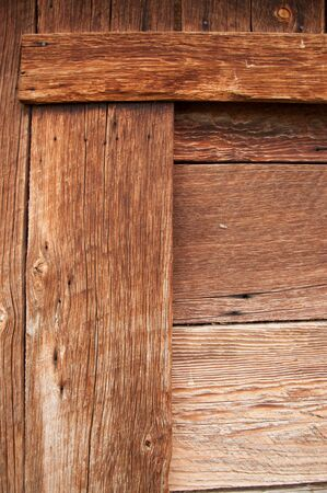 Corner of an old barn door showing all the milling and rich wood color.