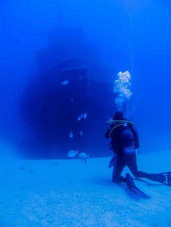 Photographing a shipwreck Фото со стока