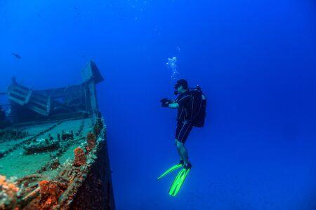 A Scuba Diver on a Wreck Фото со стока