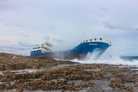 Ship aground on the coast of Malta Фото со стока