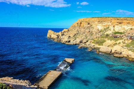 Anchor Bay, Malta with broken jetty.