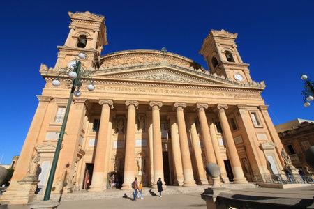 The facade of the church of  Mosta,on the Mediterranean island of Malta. Редакционное