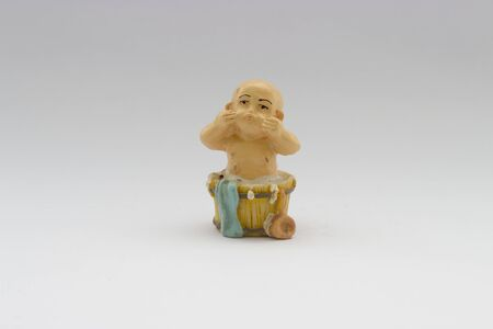 monk: old chinese ceramic young monk doll isolated