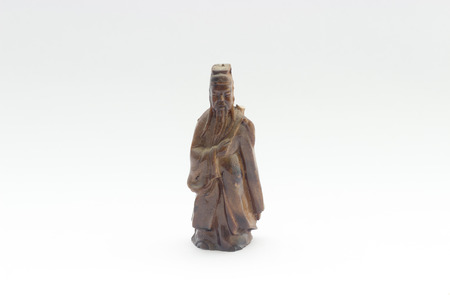 hock: old brown ceramic chinese god  white isolated