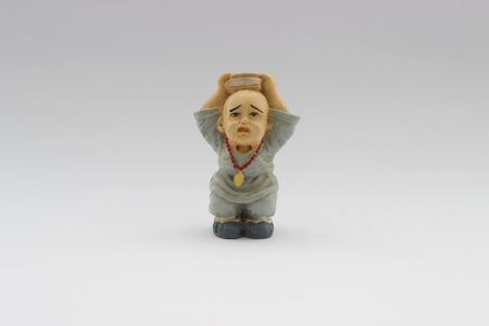ceramic: old chinese ceramic young monk doll isolated