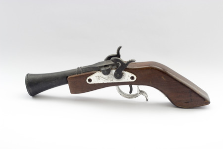 relate: A relate ancient wood gun white isolated