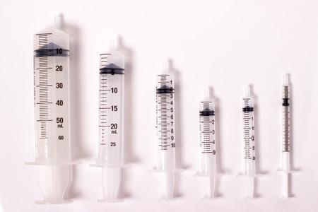 various size of syringes isolated on white Reklamní fotografie