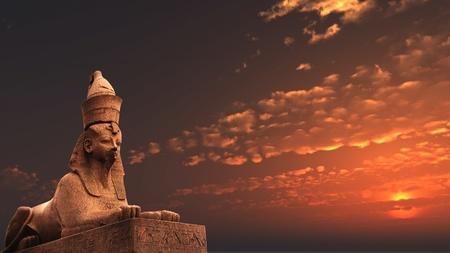 Egyptian Sphinx on sunset  sky background photo