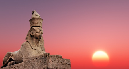 Egyptian Sphinx on the sunset  sky background photo