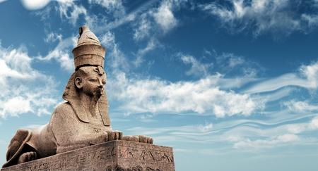 Egyptian Sphinx on blue sky background photo