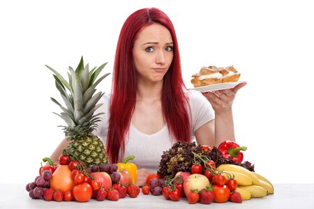 Young woman with vegetables and cake