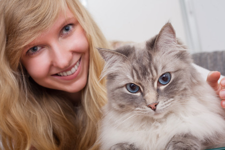 young woman with ragdoll cat