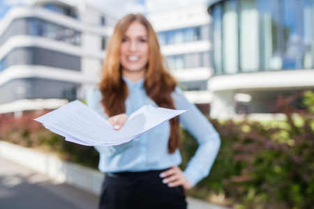 successfull: young business woman presenting contract Stock Photo