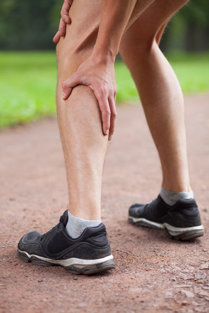 calf spasm while jogging Stock Photo