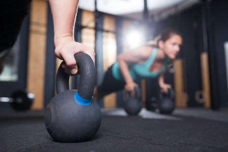 pushups on kettlebell at functional fitness  gym Stock Photo