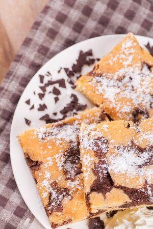 gateau: chocolate cake with powdered sugar Stock Photo