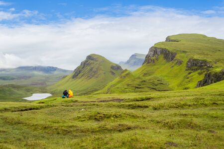 Highlands hikers rest at Quiraing at Isle of Skye