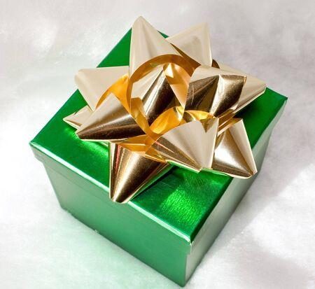 metalic: metalic green gift box with gold bow Stock Photo