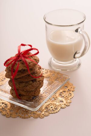 Decorative Stack of Chocolate Chip Cookies and a Glass of Milk