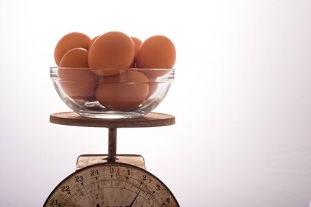 Brown Eggs in a Glass Bowl on a Scale