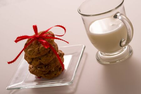 Chocolate Chip Cookie Stacked with Red Bow and Glass of Milk
