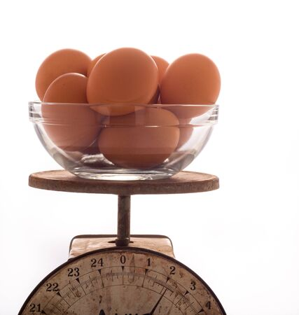 Brown Eggs in a Glass Bowl on an Old Scale