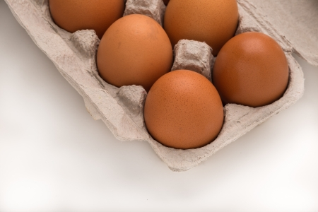 Carton of Brown Eggs Close Up Stock Photo