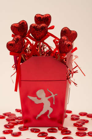 Box with Cupid and Hearts for Valentines Day Stock Photo