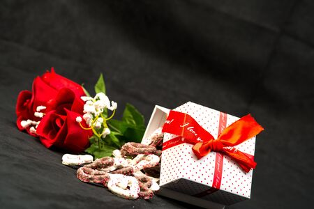Red Roses and Candy for Valentines Day Stock Photo